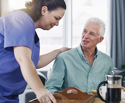 Home Care assistant helping a client